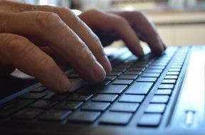 hands typing keyboard
